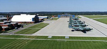 Aerial photo of 8 C-130s on a flight line